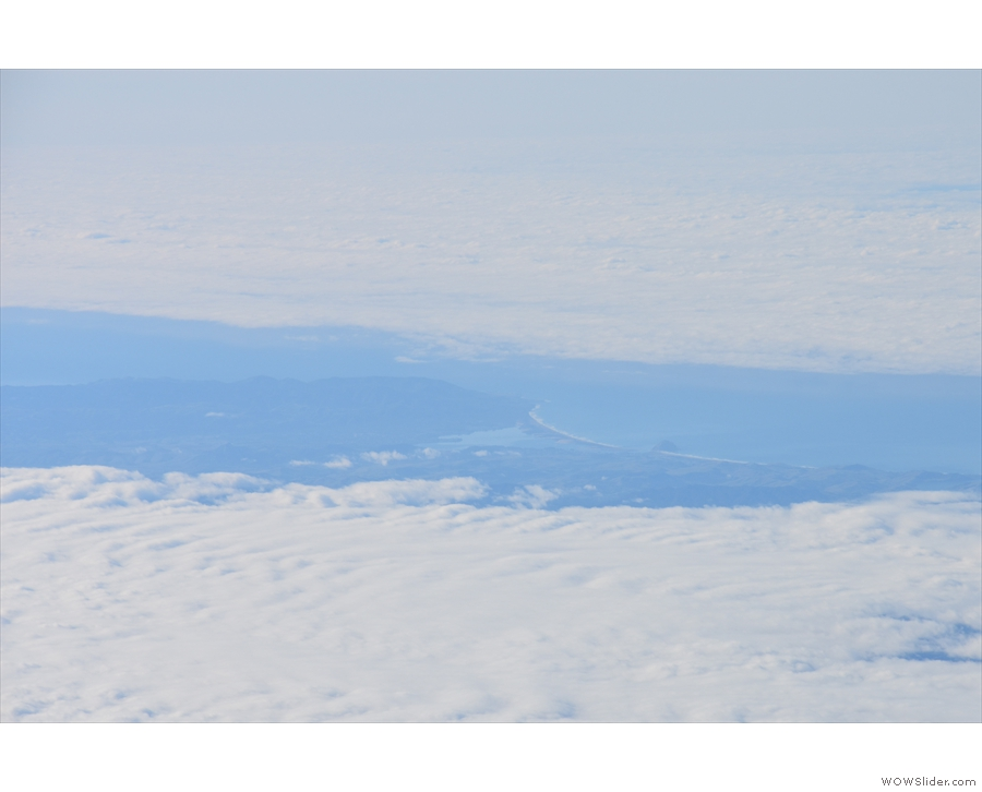 My final view of the coastline, 20 minutes into the flight, through a gap in the clouds.
