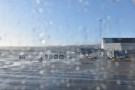 We pushed back and waited for our turn to take off. Overnight rain had left the window...