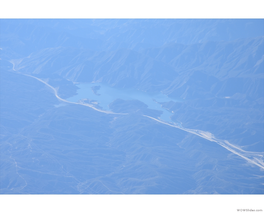 I can't be 100% certain, but I think that this might be Pyramid Lake and the road is I5...