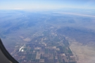 An hour into the flight and suddenly there's water and agriculture. This has to be...