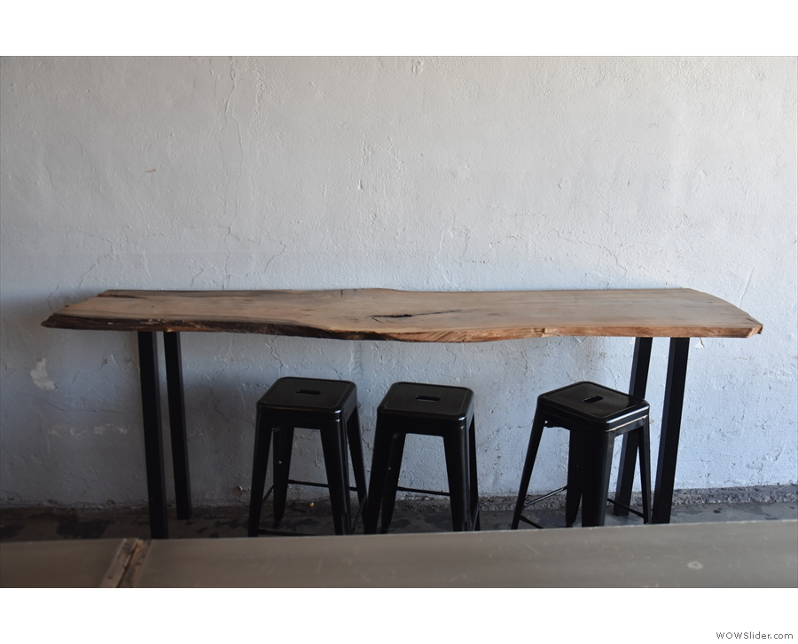 ... with a narrow, three-person table against the wall to the right.