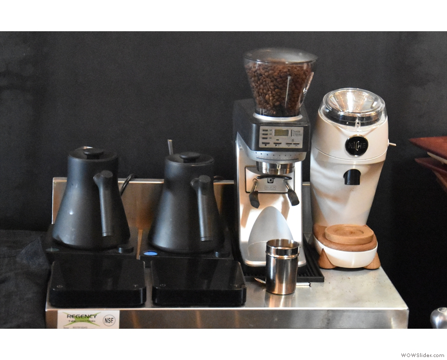 The kettles and grinder for the pour-over set up are behind the till/menus.