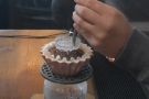 ... the Melodrip, a device designed to reduce the agitation of coffee grounds.