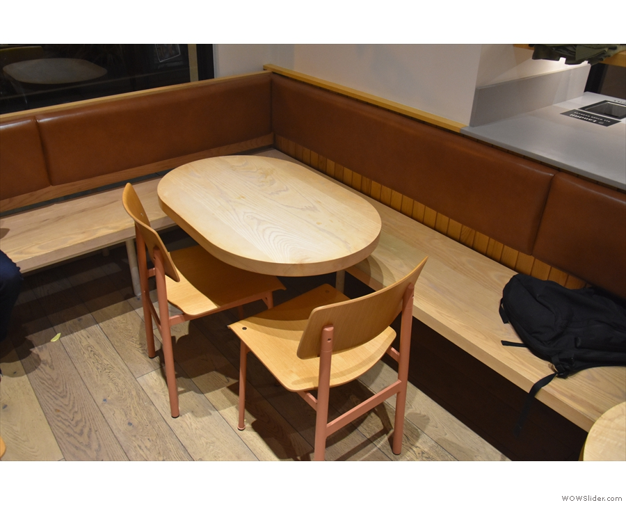 The L-shaped bench has four tables in all, including this oval one in the corner.
