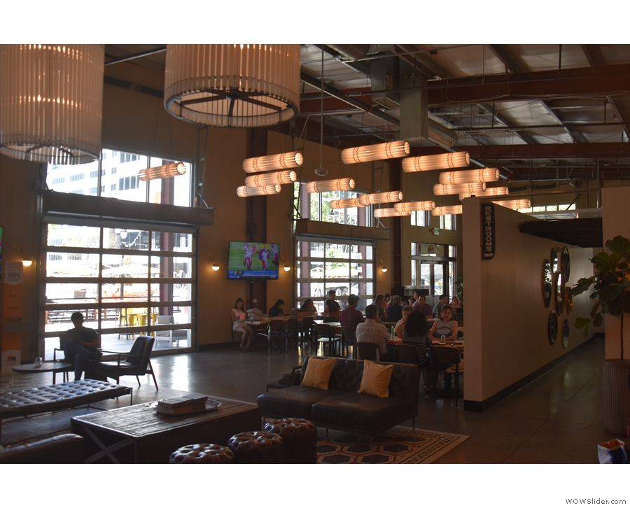 A view of the communal seating area from by the bar.