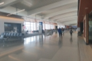 The terminal itself is this long, wide, bright corridor, with gates on one side...