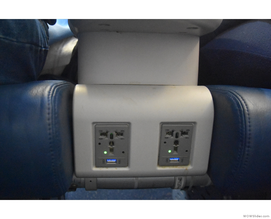 There's more power, a full international plug and another USB outlet, between the seats.