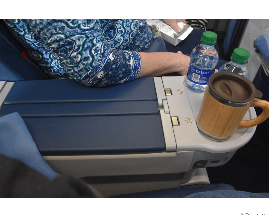 Finally, there's one more USB outlet in the wide central armrest between the seats.