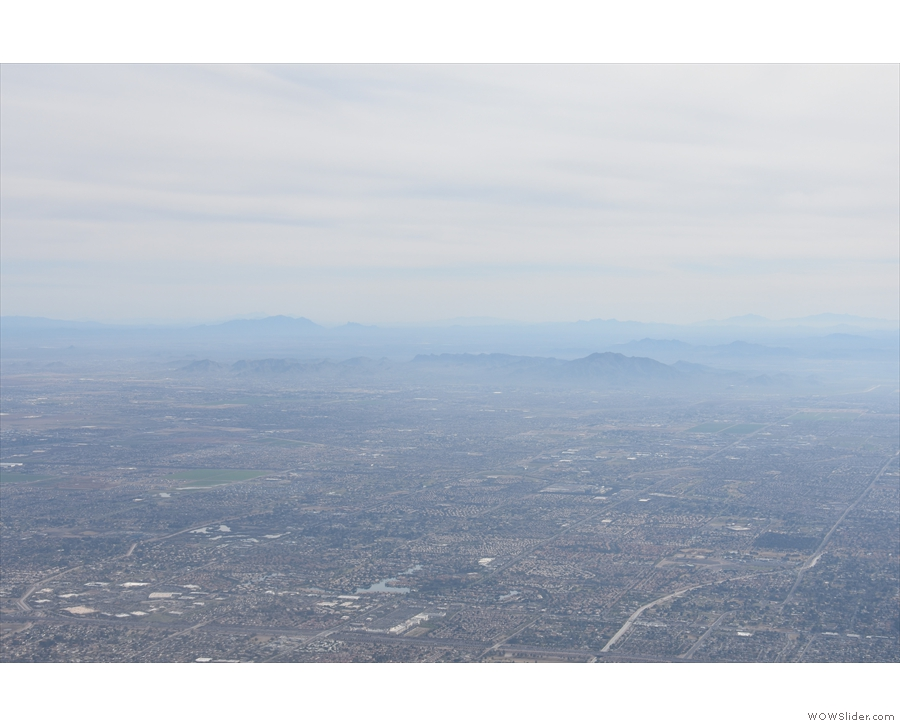 Looking of the southeast across Gilbert, we catch a distant glimpse of what I think...