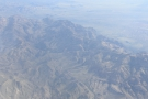 As we cross over to the Superstition Mountains, down below is the Apache Trail...