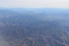 I never tire of flying over mountains.