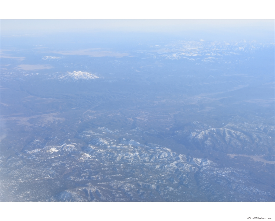 More snow-capped mountains, probably in western New Mexico.