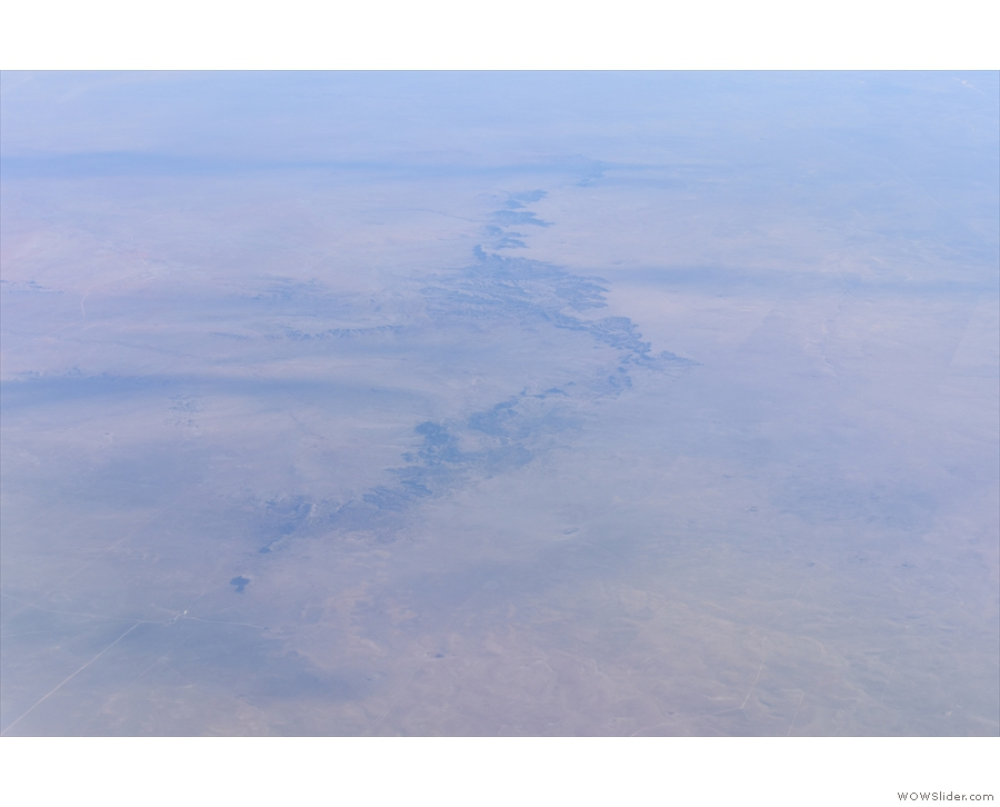 ... gouged by river valleys like this one (I think that's the Pecos River).