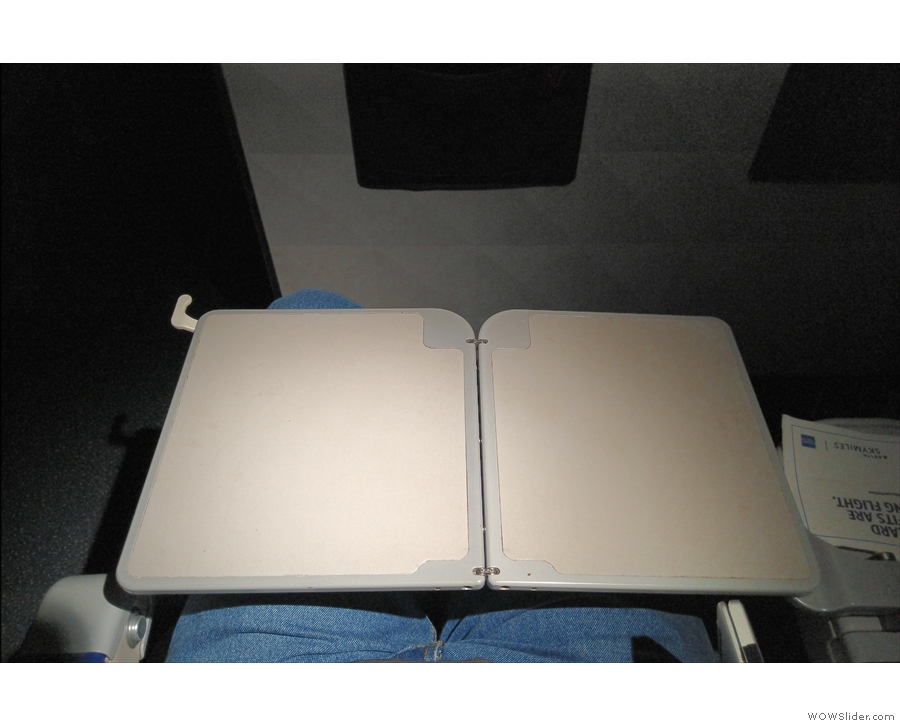 ... and folded out to its full width (just not wide enough to reach the other armrest!).