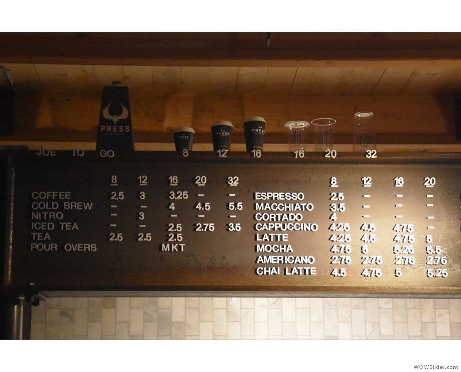 The coffee menu, and drink sizes, are on a girder above the counter.