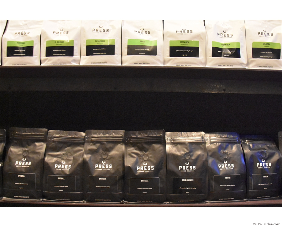There are retail bags of blends (bottom, in black) and single-origins (top, in white)...