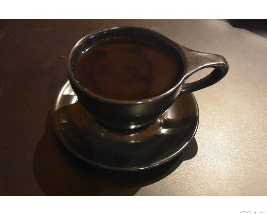 Here's my Guatemala del Florida filter in a black cup on a black saucer on a black table.