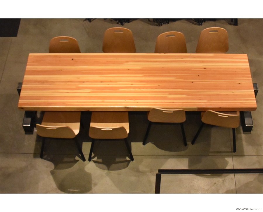 The seating at the front of Press, starting with the eight-person communal table...