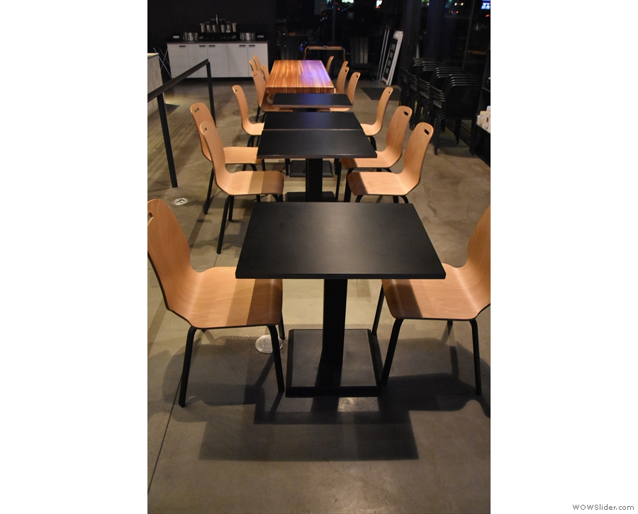This row of four two-person tables, plus an eight-person communal table, is at the front.
