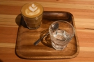 ... a cortado made with the Colombian single-origin espresso, served on a small wooden...