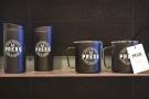 ... along with various pieces of merchanise, including MiiR mugs/tumblers, again in black...