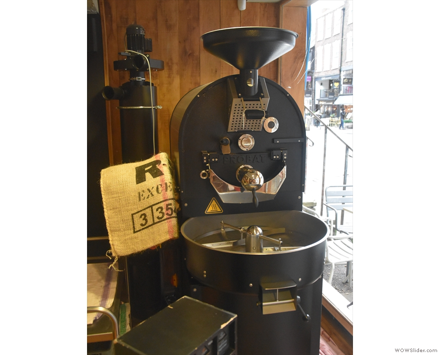 Taking pride of place in the window to the right is the Probat roaster...