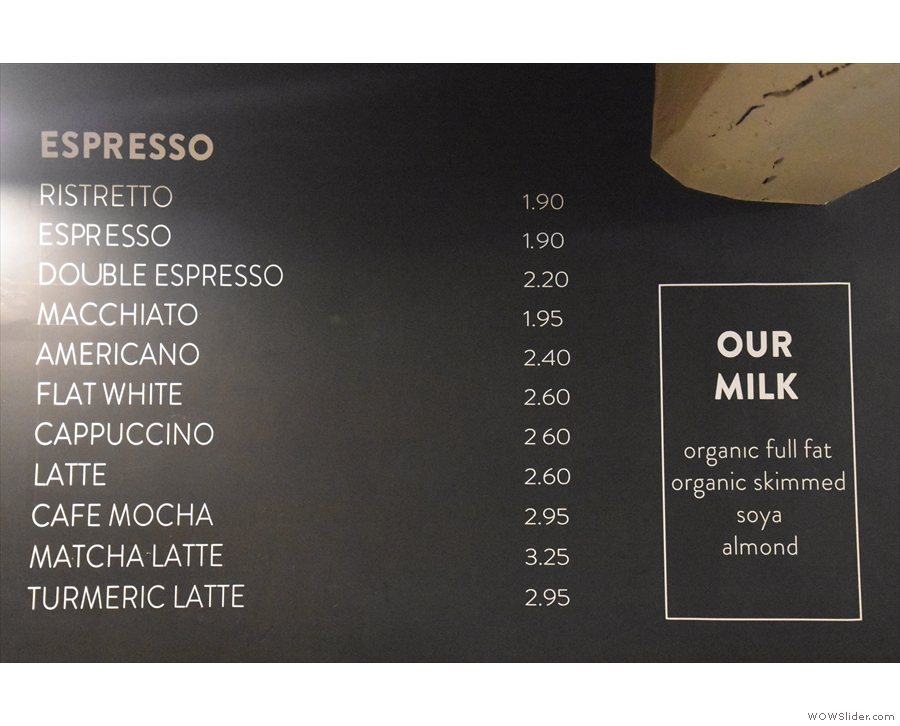 ... with the espresso menu on the wall behind...