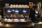 Behind the cakes is the three-group Sanremo Cafe Racer espresso machine...