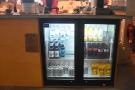 The cold drinks, by the way, are in this chiller cabinet down the side of the counter.
