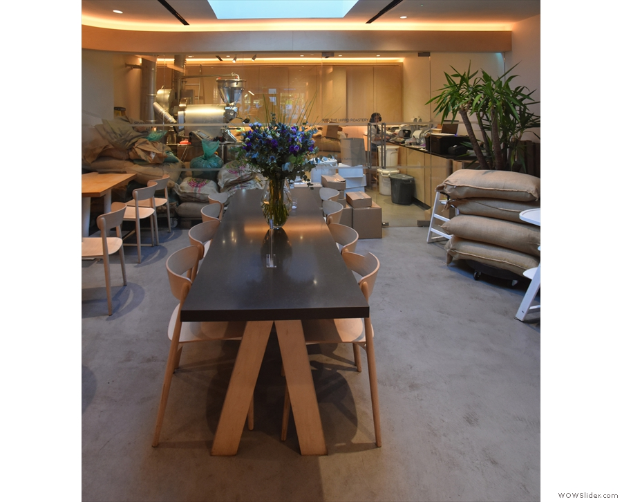 There's a large, eight-person communal table in the centre, under a skylight...