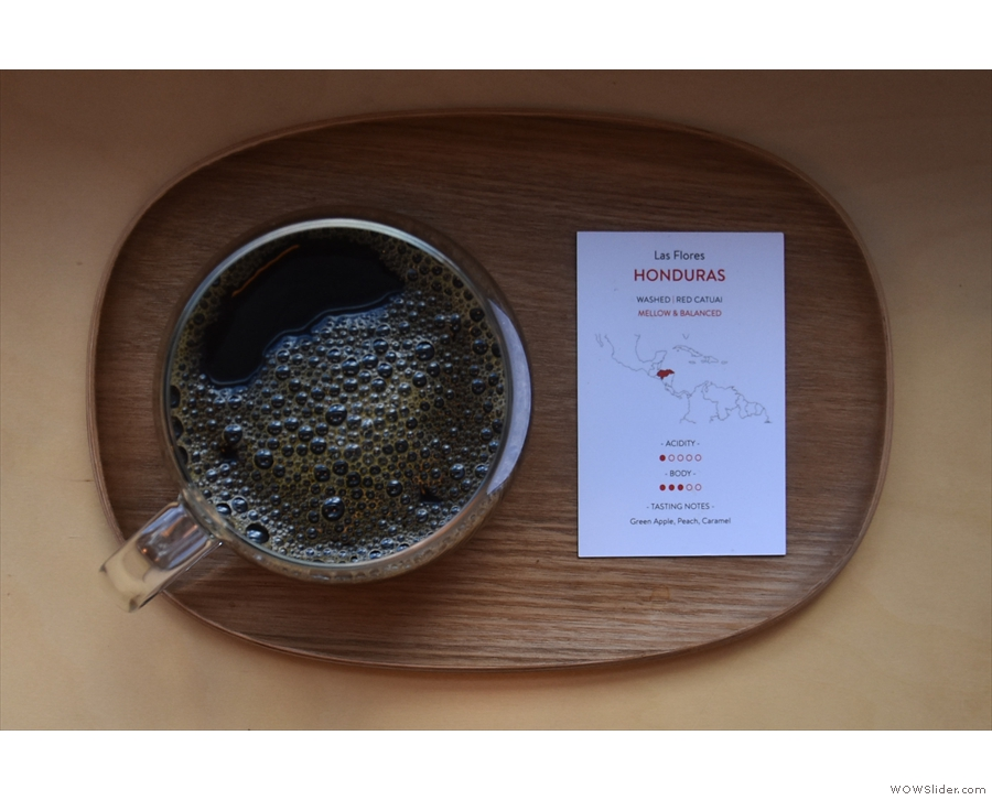 ... served in a glass Kinto cup, presented on a wooden tray, complete with tasting notes.