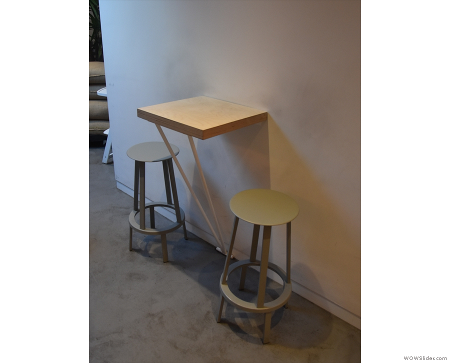 ... starting with this two-person table projecting from the wall.