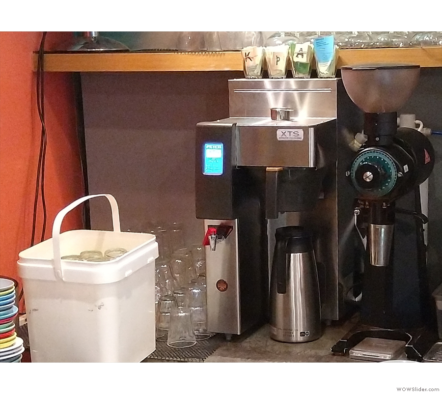 The batch brewer is against the wall behind the counter, along with its own EK43 grinder.
