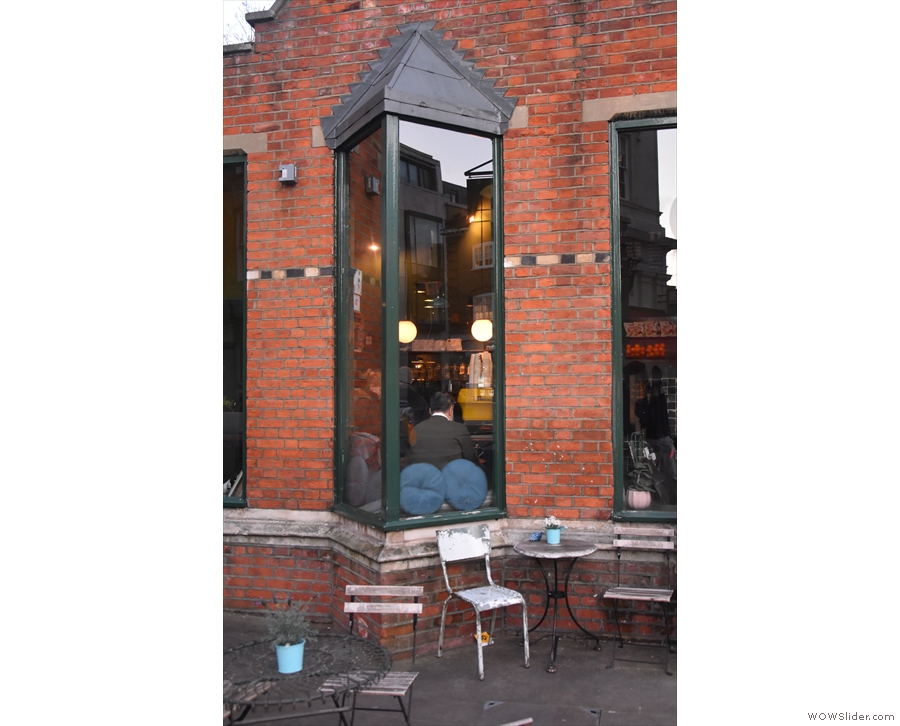 ... and a final, two-person table tucked away by the window at the foot of the ramp.