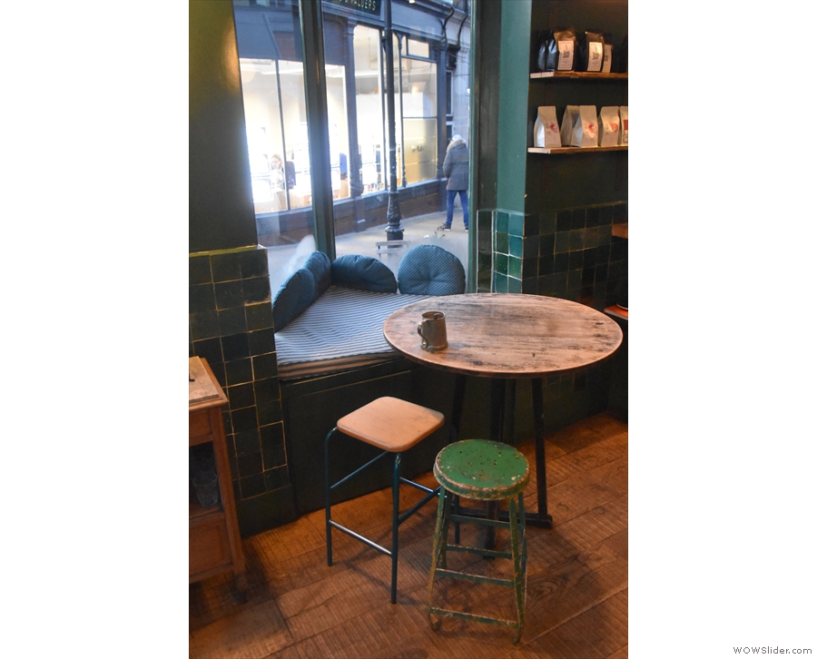 ... where you'll find this round table, the projecting windowsill being used as a seat.