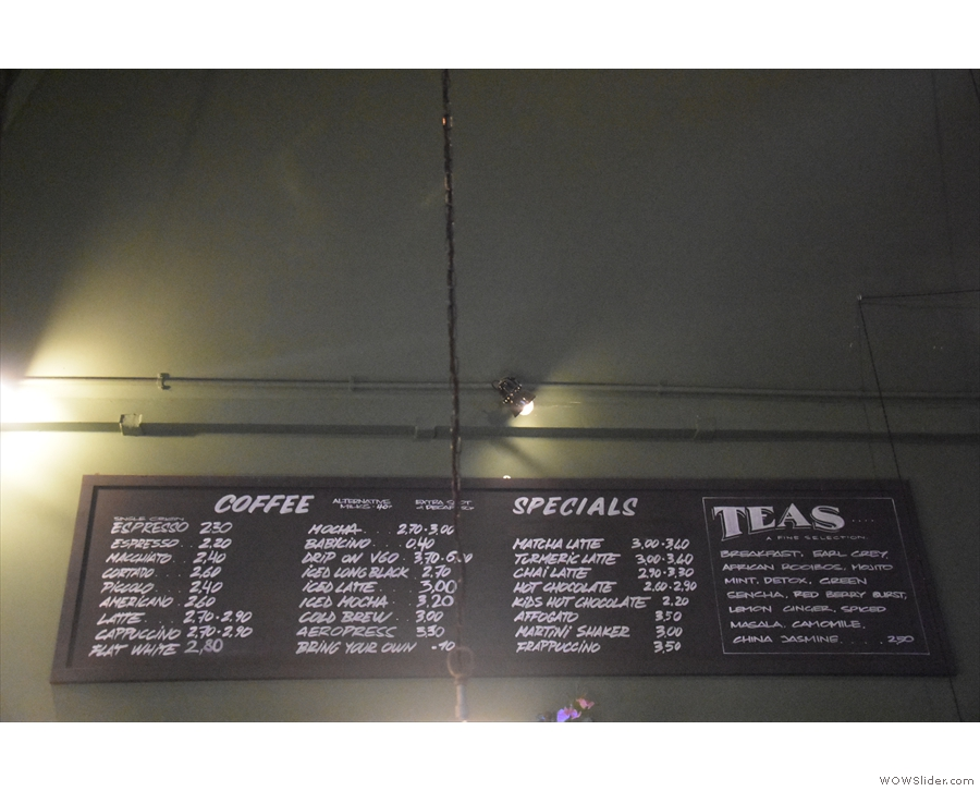 The drinks menu, meanwhile, is on the wall above/behind the counter.