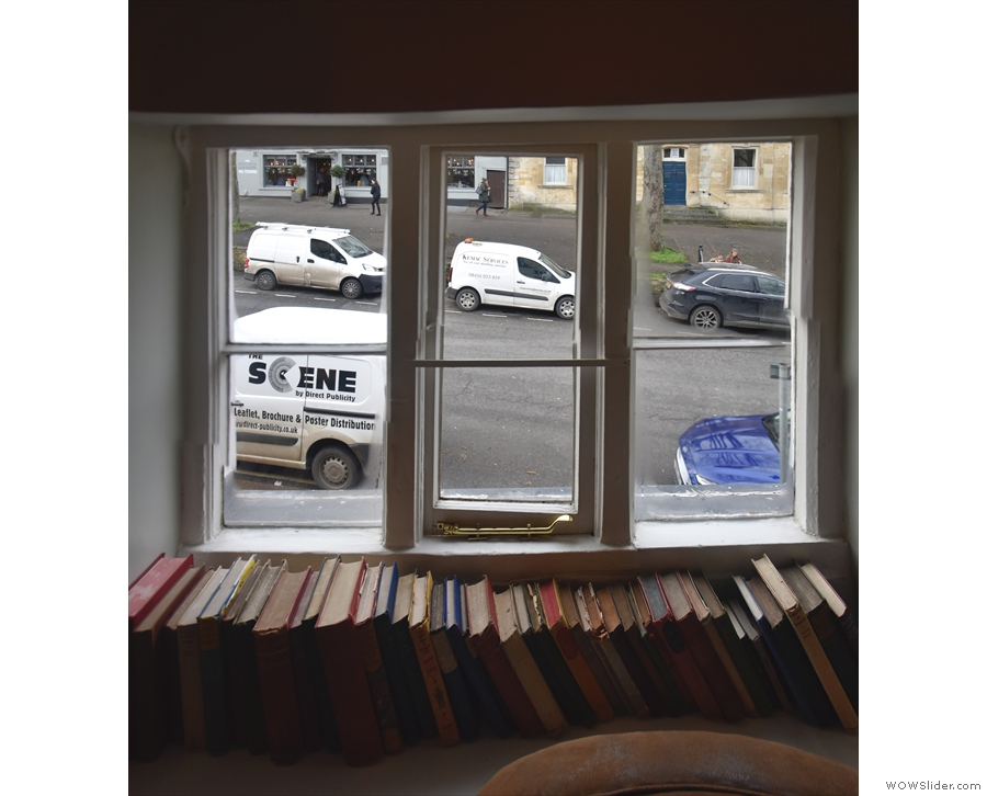 The view out of the window. Check out the windowsill which is used as a bookshelf.