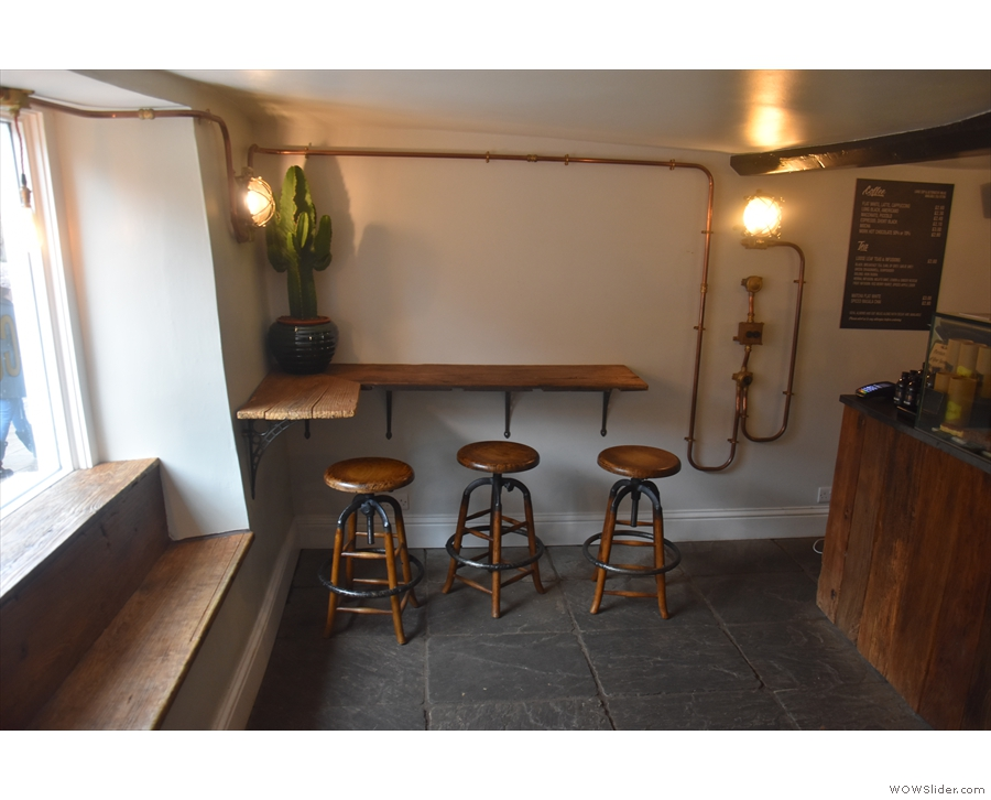 ... where you'll find this three-person, L-shaped bar.