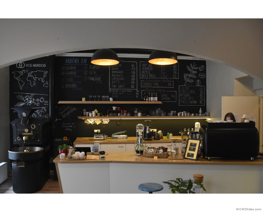 To business. The counter separates the two sides of Dos Mundos: coffee shop & roastery.