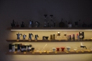 There are retail shelves everywhere. Coffee-making equipment lines the right-hand wall...