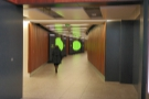 After security, you find yourself in a long, multicoloured corridor...