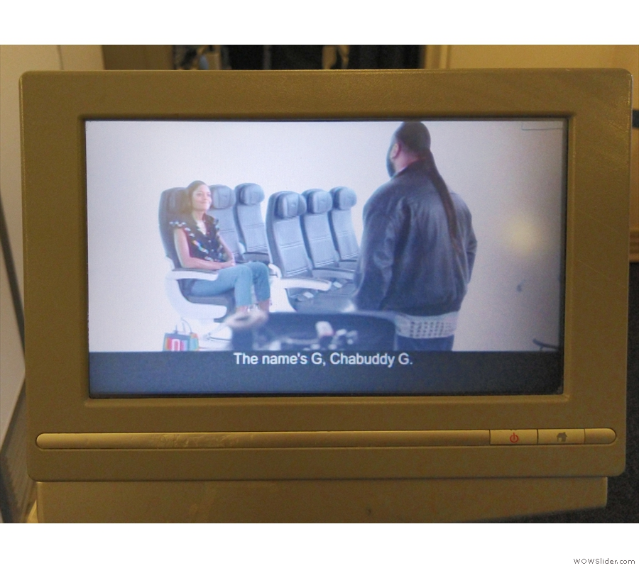 For World Traveller (aka economy), it's a pretty decent size and a widescreen too.