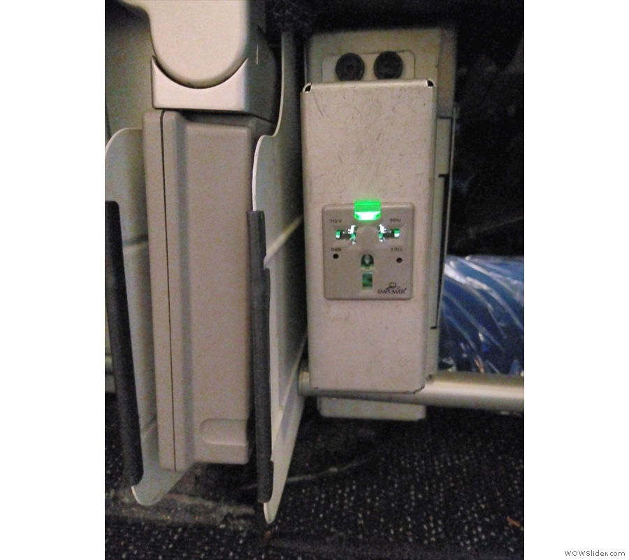 ... and a full, multi-national power outlet beneath the seat. Awesome!