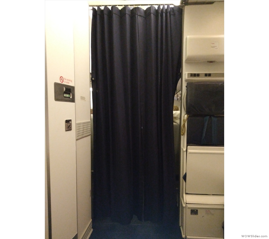 At some point, the cabin crew finally closed the curtain to the World Traveller Plus cabin.
