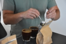 ... to smell the brewed coffee. Once broken, the crust is removed from the coffee.