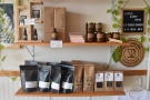 ... beneath which are the retail bags of coffee, including some local roasters...
