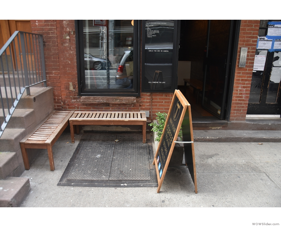 A pair of benches, arranged in an L-shape, provides the only outdoor seating.