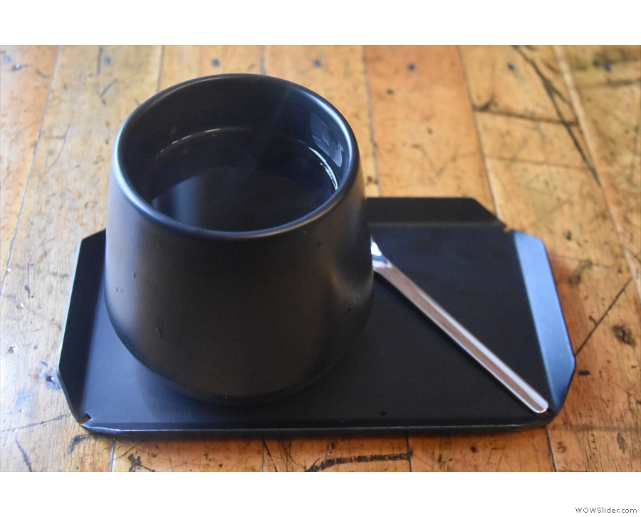 Our coffee, served on a metal tray in a gorgeous handleless cup.