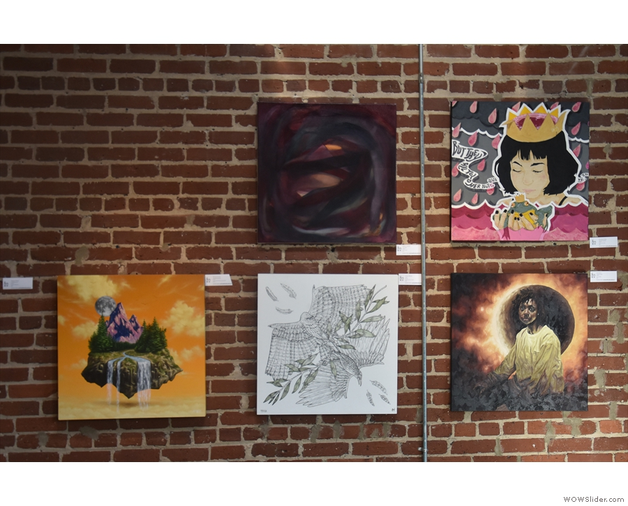 The exposed brick walls are covered with works of art, all of which, I believe, are for sale.