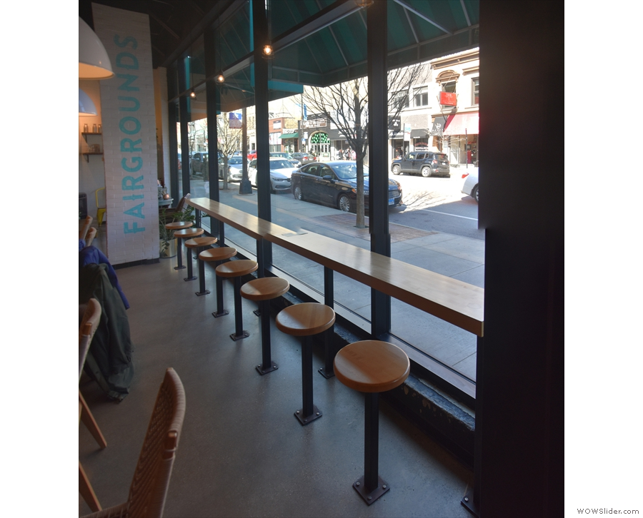 ... while to the right of the door is an eight-person window-bar with fixed stools.
